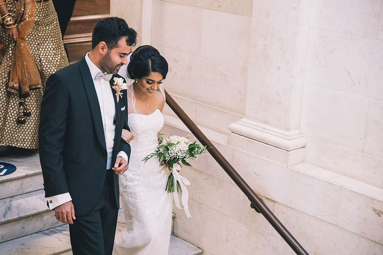 Bride and groom just married at Old Marylebone Town Hall in London at July 2020 wedding