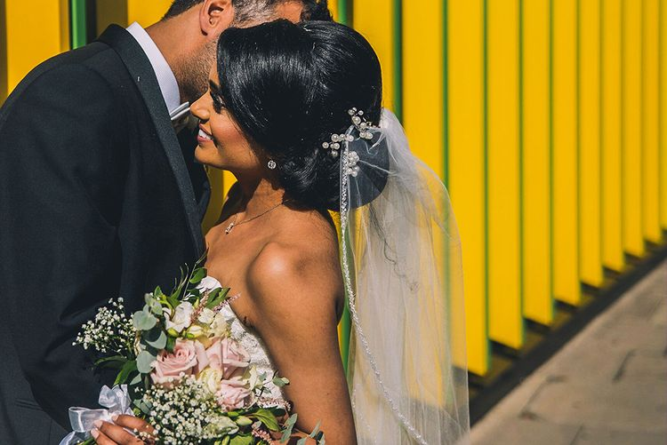 Asian bride with chic chignon wedding hair and veil