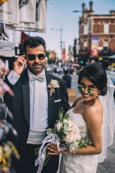 Bride and groom trying on glasses
