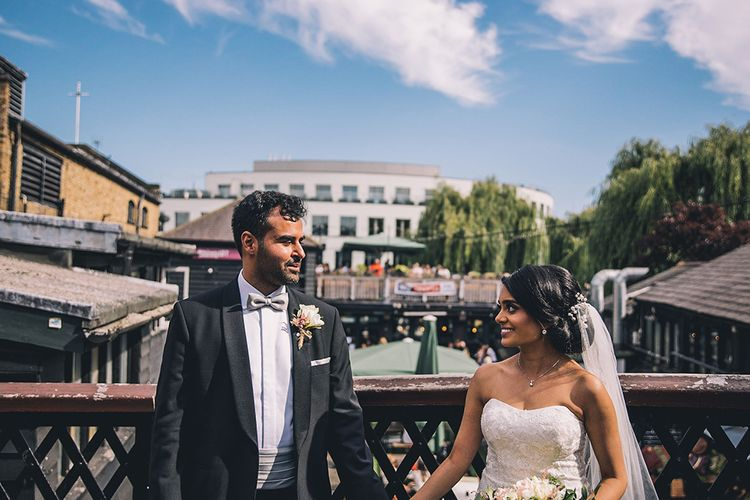 Bride and groom portrait on the bridge at Camden Town