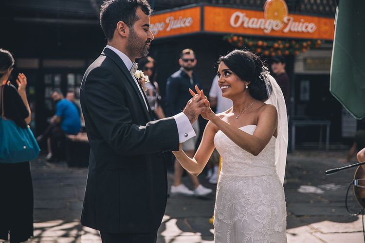 Bride and groom first dance outside at socially distanced wedding
