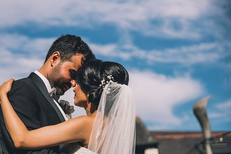 Intimate wedding portrait by Story + Colour Photography