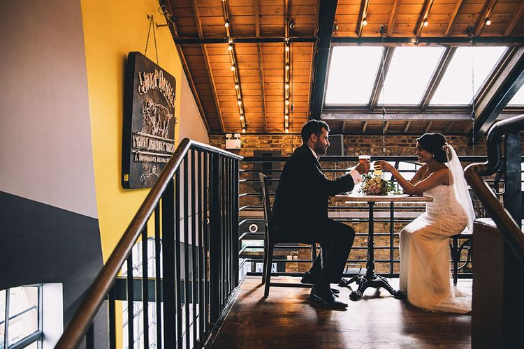 Bride and groom enjoying a quiet drink at socially distanced July 2020 wedding