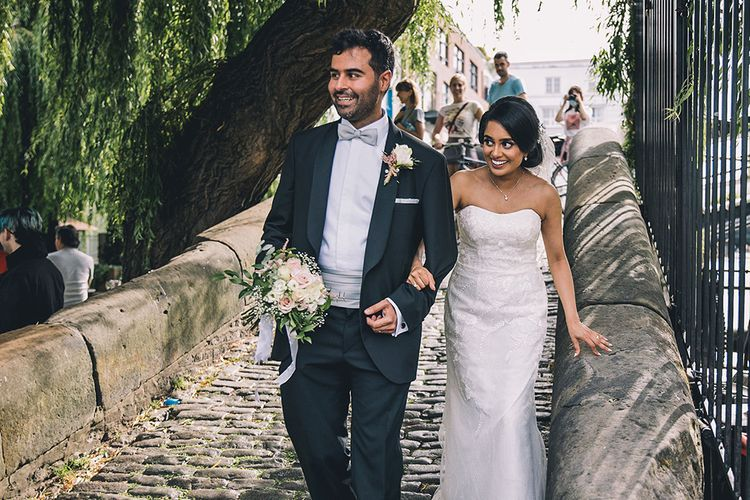 Bride in strapless wedding dress and groom in tuxedo at July 2020 wedding