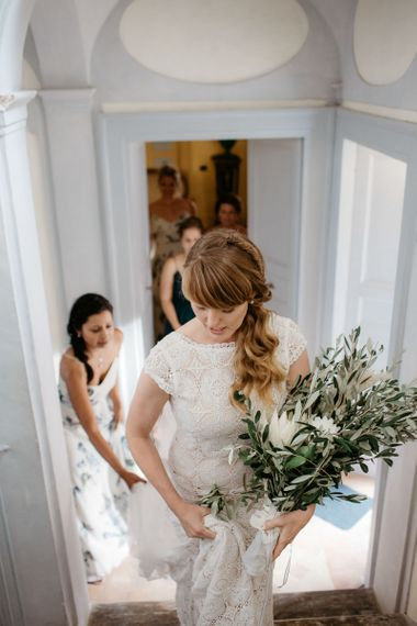 Bride with side ponytail and large bouquet