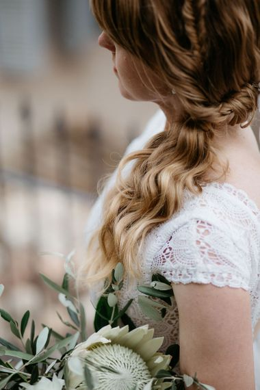 Side ponytail with braid for bride