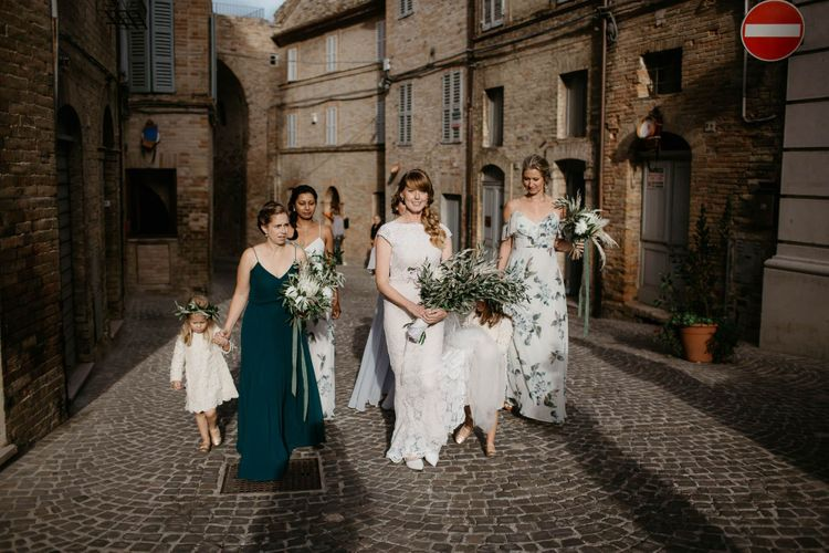 Bridal party make their way to wedding ceremony in Italy