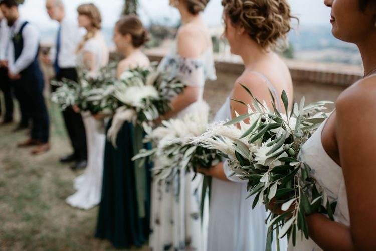 Bridal party in mismatched green dresses