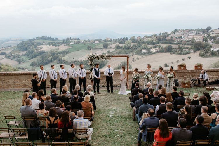 Outdoor wedding ceremony at destination wedding in Italy with amazing views