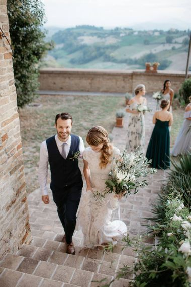 Bride with side ponytail makes her way to reception