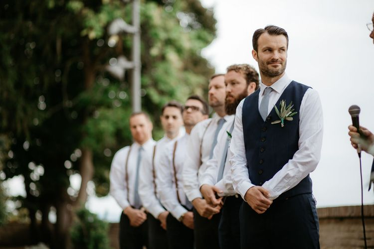Groom with his groomsmen in matching outfits