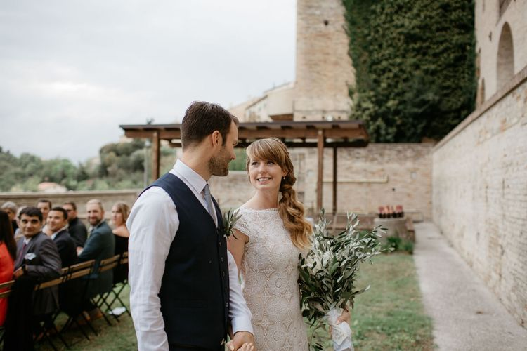 Bride with side ponytail and lace dress