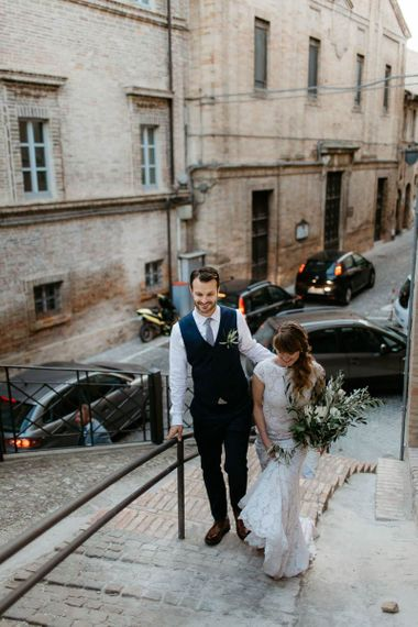 Bride and groom make their way to wedding reception