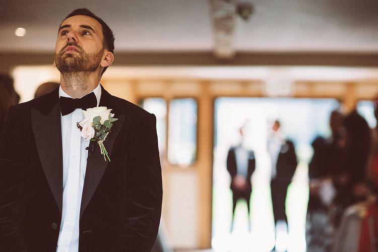 Groom at the Altar in Black Tie Suit | Blush Pink & Red, Christmas, Winter Wedding at Coltsfoot Country Retreat | Lemonade Pictures