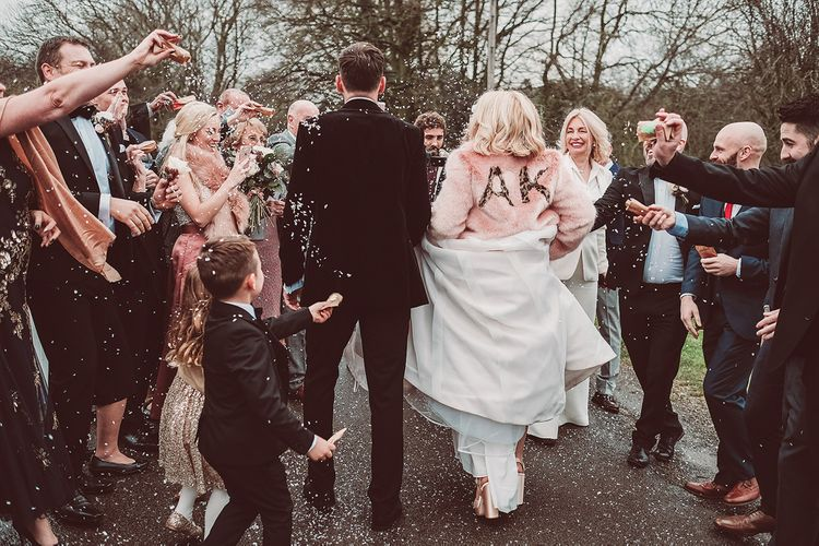 Confetti Moment | Bride in Organza Justin Alexander Gown & Blush Pink Customised Faux Fur Coverup | Groom in Black Tie Suit | Blush Pink & Red, Christmas, Winter Wedding at Coltsfoot Country Retreat | Lemonade Pictures
