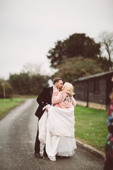 Bride in Organza Justin Alexander Gown & Blush Pink Faux Fur Coverup | Groom in Black Tie Suit | Blush Pink & Red, Christmas, Winter Wedding at Coltsfoot Country Retreat | Lemonade Pictures