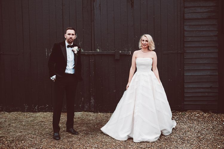 Bride in Organza Justin Alexander Gown | Groom in Black Tie Suit | Blush Pink & Red, Christmas, Winter Wedding at Coltsfoot Country Retreat | Lemonade Pictures