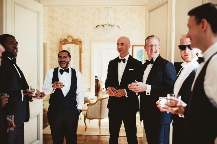 Groomsmen in tuxedos on wedding morning