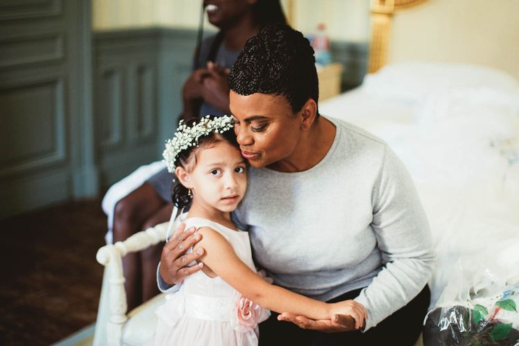 Grandmother and flower girl with gypsophila flower crown on wedding morning