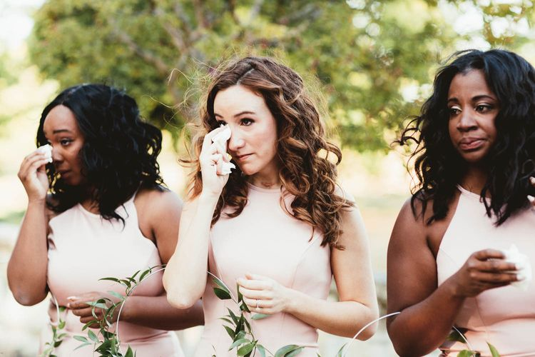 Emotional bridal party in pink bridesmaid dresses