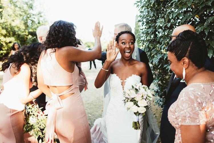 Happy bride in strapless Pronovias wedding dress