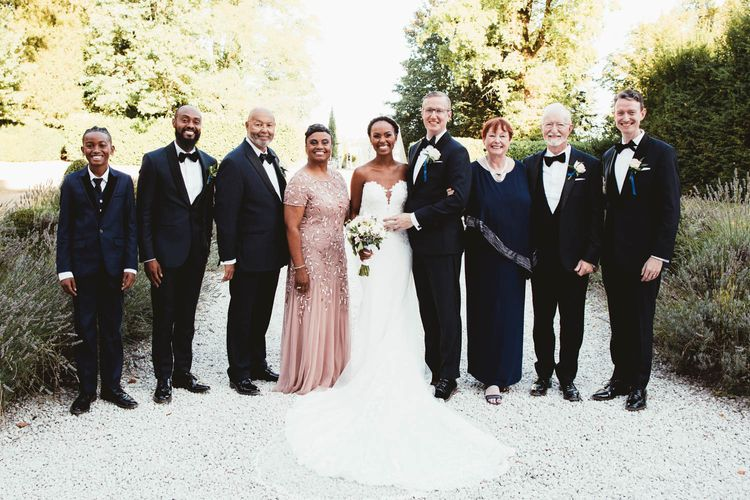 Portrait of the bride and groom with their immediate families
