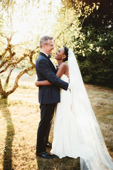 Golden hour portrait by Maryanne Weddings for destination wedding with pink bridesmaid dresses
