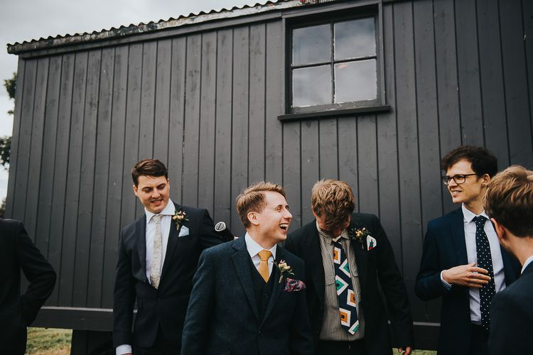 Groom in Navy Tweed Suit by Walker Slater with Yellow Tie and Patterned Pocket Square | Groomsmen in Mismatched Navy Suits | 'Frida Kahlo' Flower Crown, Halfpenny London Bridal Separates and Colourful Bouquets with Peonies for Suffolk Wedding | From The Smiths Photography