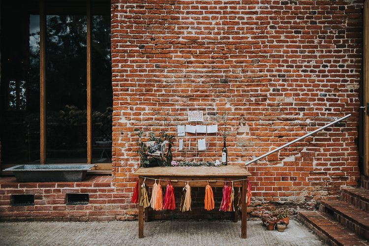 Metal Frame Table Plan | Rustic Wooden Bureau | Red, Orange and Gold Tassels | Cards Box Decorated with Foliage | 'Frida Kahlo' Flower Crown, Halfpenny London Bridal Separates and Colourful Bouquets with Peonies for Suffolk Wedding | From The Smiths Photography