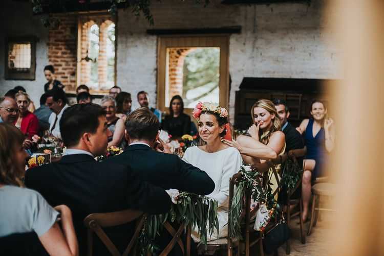 Bride in Halfpenny London Separates of Laura Top with Cowl Back and Long Sleeves, Silk Cami and Laser Cut Palm Skirt | Flower Crown with Pink Peony | 'Frida Kahlo' Flower Crown, Halfpenny London Bridal Separates and Colourful Bouquets with Peonies for Suffolk Wedding | From The Smiths Photography