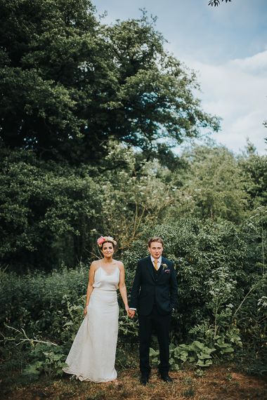 Bride in Halfpenny London Separates of Laura Top with Cowl Back and Long Sleeves, Silk Cami and Laser Cut Palm Skirt | Flower Crown with Pink Peony | Groom in Navy Tweed Suit by Walker Slater with Yellow Tie and Patterned Pocket Square | Colourful Bridal Bouquet of Pink and White Peonies | Suffolk Wedding | From The Smiths Photography