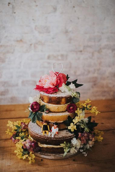 Three-Tier Naked Wedding Cake Decorated with Pink and Yellow Flowers and Lego Figures | 'Frida Kahlo' Flower Crown, Halfpenny London Bridal Separates and Colourful Bouquets with Peonies for Suffolk Wedding | From The Smiths Photography