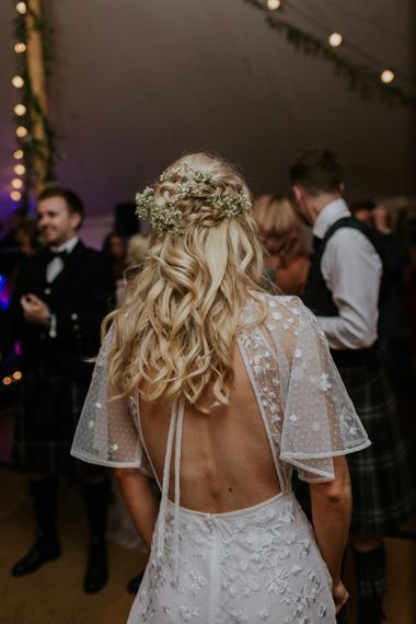 Open back ASOS wedding dress with sheer polka dot sleeves and floral appliqué details
