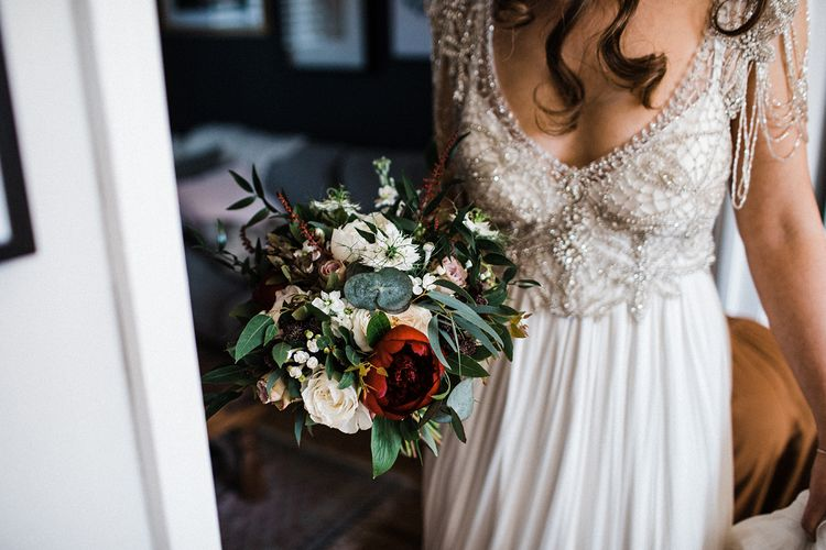 Anna Campbell Wedding Dress With Red and Bridal White Bouquet