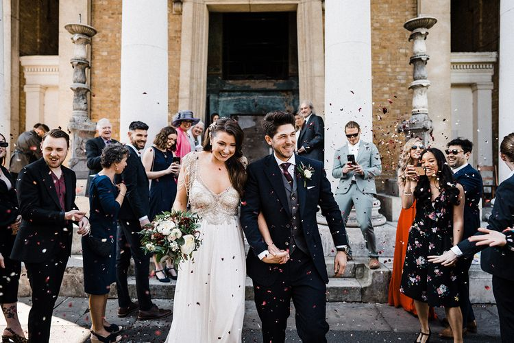 Confetti Exit with Bride Wearing Anna Campbell Wedding Dress With Beaded Detail