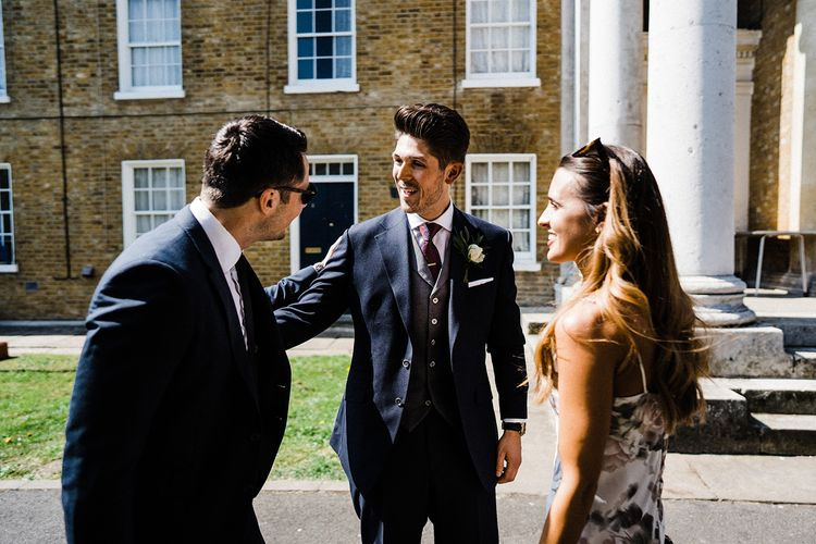 Groom Greets Guests At Asylum Chapel In London