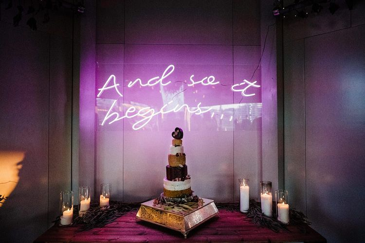 Neon Wedding Sign And Cheese Tower