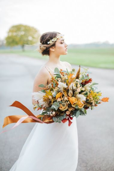 Large Orange Bouquet by Flowers by Suzanne Image by Nikkis Moments Photography