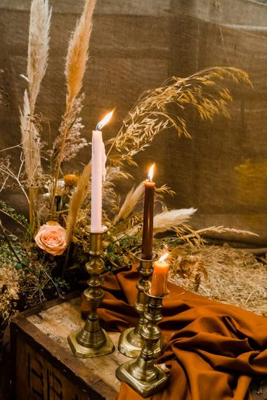 Romantic Candle Light with Coloured Candles and Gold Candlesticks