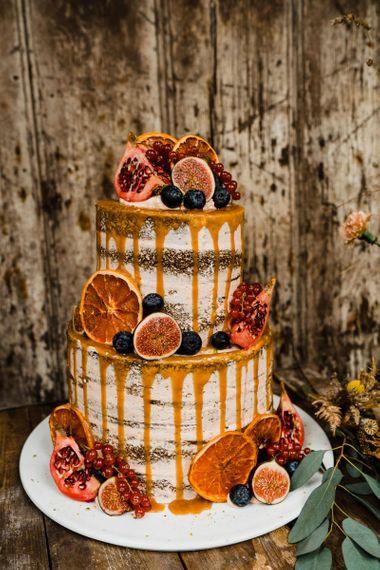 Semi Naked Wedding Cake with Orange Drip and Fig Decor
