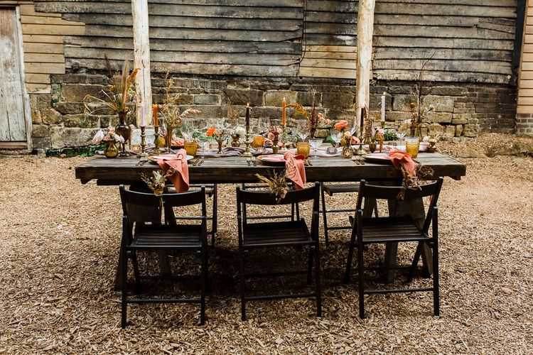 Rustic Tablescape with Candles, dried Grasses and Coral Linen