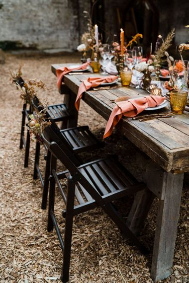 Black Wooden Chairs and Coral Napkins for Reception Table