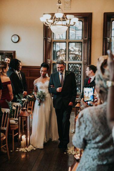 Wedding ceremony bridal entrance in Mira Zwillinger dress