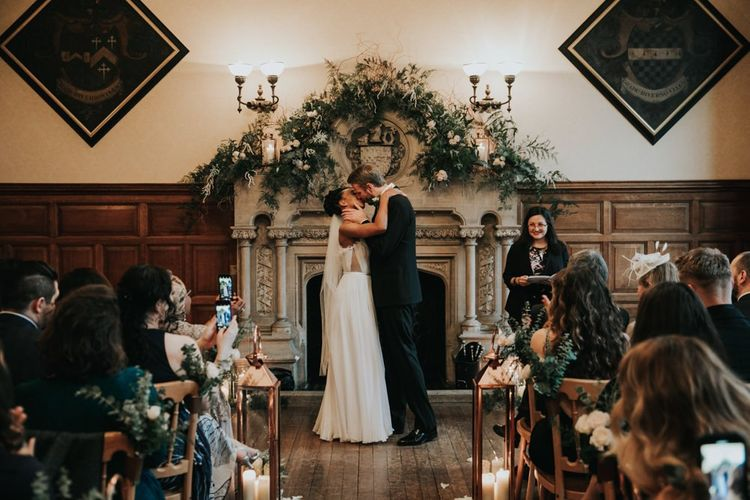 Bride and groom kissing at The Elvetham wedding ceremony