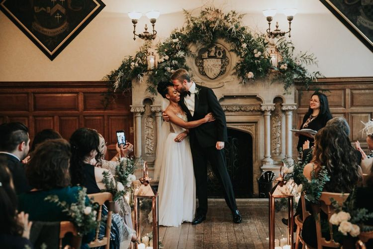 Black tie wedding with Mira Zwillinger wedding dress and tuxedo