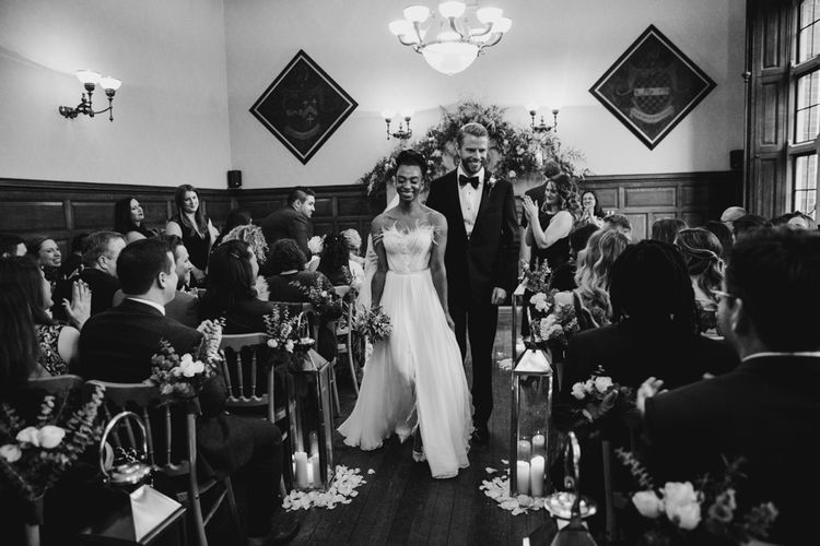 Bride and groom walking up the aisle as husband and wife
