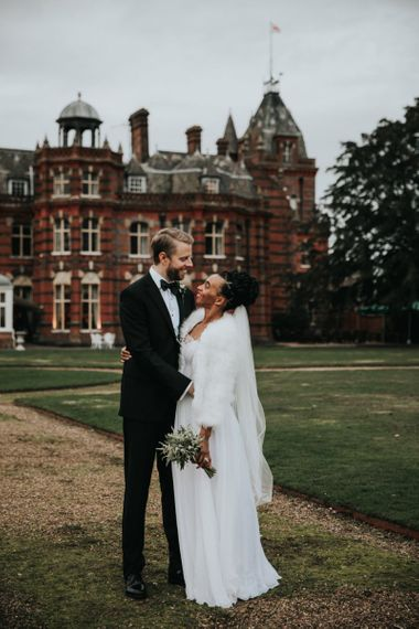 Wedding portrait by Natalie J Weddings of bride and groom outside  The Elvetham wedding venue in Hampshire