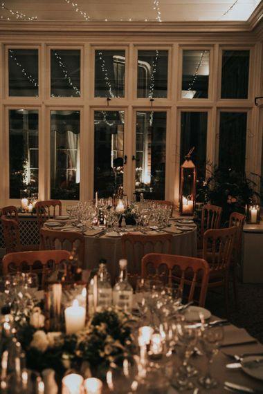 Romantic candlelight reception at The Elvetham wedding venue