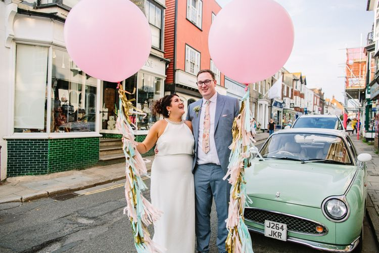 Balloon Filled Festival Wedding At The George In Rye // Pastel Coloured Wedding Decor // Bridesmaids In Pink // Images By Storyett