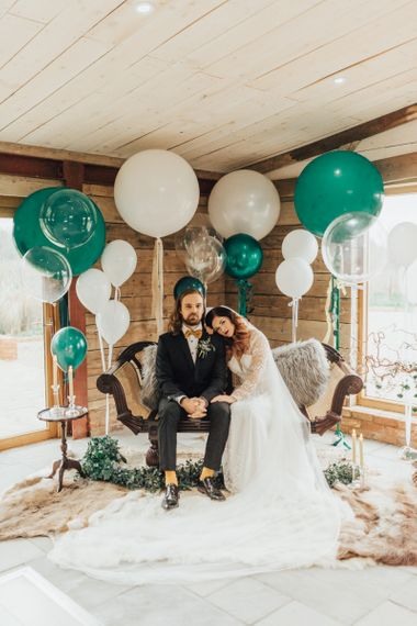 Green and White Giant Balloon Wedding Decor with Bride in  Lace Wedding Dress and Groom in Bow Tie